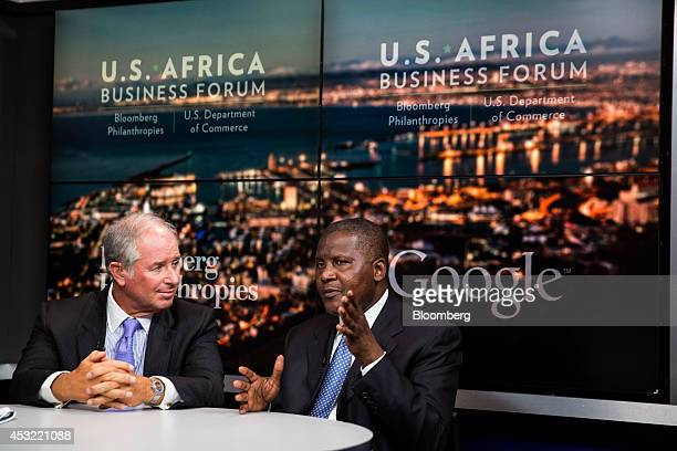 Stephen Schwarzman chairman chief executive officer and cofounder of Blackstone Group LP left and Aliko Dangote president and chief executive officer...