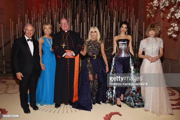 Stephen Schwarzman Christine Schwarzman Cardinal Timothy Michael Dolan Donatella Versace Amal Clooney and Anna Wintour attend the Heavenly Bodies...