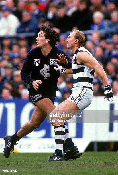 Stephen Silvagni of the Blues and Gary Ablett of the Cats in action during a AFL match between the Carlton Blues and the Geelong Cats held at the...