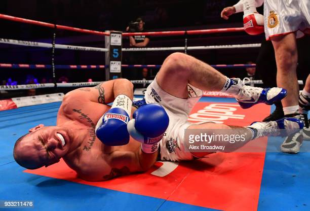 Stephen Simmons is knocked down by Matty Askin during their British Crusierweight Title fight at York Hall on March 17, 2018 in London, England.