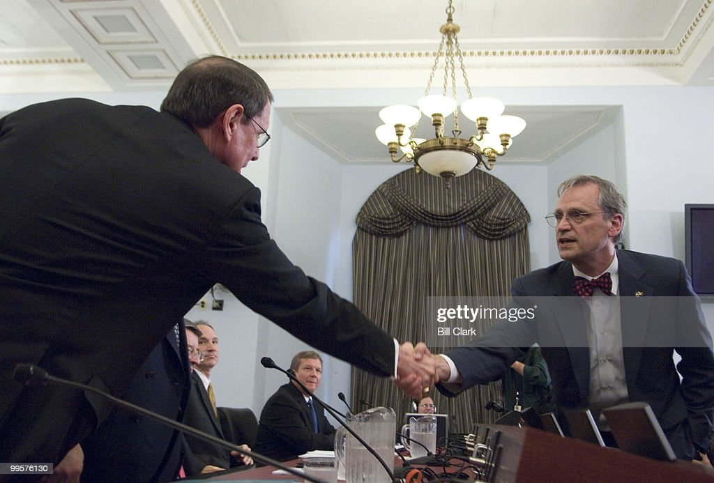 Stephen Simon, senior vice president of Exxon Mobil Corp., shakes hands with Rep. Earl Blumenauer, D-Ore., before the start of the House (Select) Energy Independence and Global Warming Committee hearing on 'Drilling for Answers: Oil Company Profits, Runaway Prices and the Pursuit of Alternatives,' on Tuesday, April 1, 2008. In the back from left are Peter Robertson, vice chairman of Chevron, John Lowe, executive vice president of ConocoPhillips, and Robert Malone, chairman and president of BP America, Inc.,