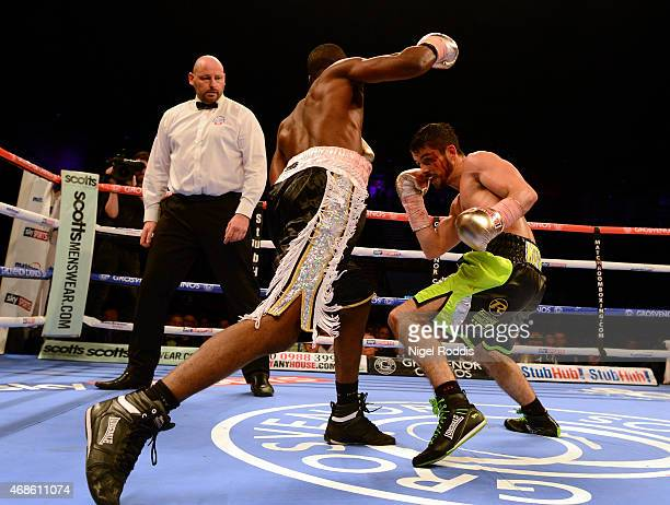 Stephen Smith in action with Barrington Brown during their Featherweight boxing contest at the Metro Arena on April 4 2015 in Newcastle upon Tyne...
