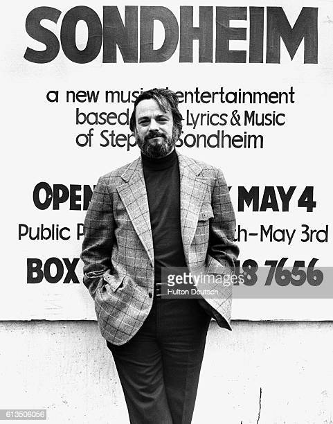 Stephen Sondheim the American composer and lyricist stands beside an advertisement for one of his shows