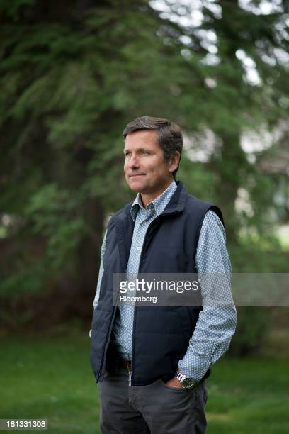 Stephen Steve Burke president and chief executive officer of NBCUniversal Media LLC stands for a photograph during the Allen Co Media and Technology...