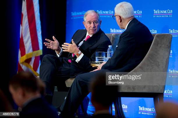 Stephen 'Steve' Schwarzman cofounder chairman and chief executive officer of Blackstone Group LP left talks to David Rubenstein cofounder and cochief...