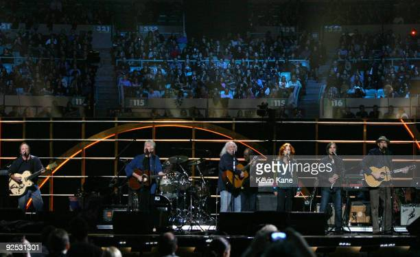 Stephen Stills David Crosby of Crosby Stills and Nash with Bonnie Raitt Jackson Browne and James Taylor perform onstage at the 25th Anniversary Rock...