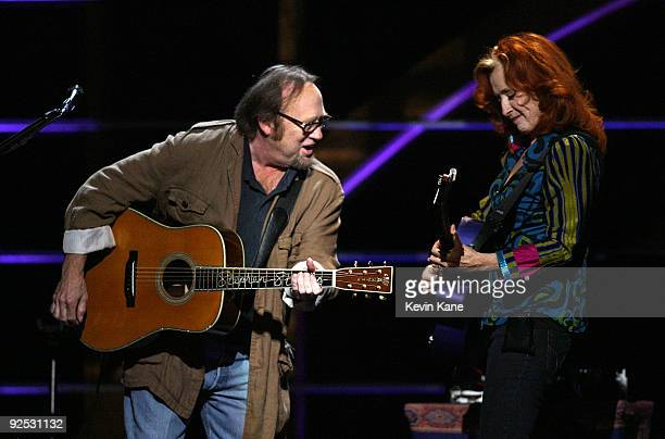 Stephen Stills of Crosby Stills and Nash with Bonnie Raitt performs onstage at the 25th Anniversary Rock Roll Hall of Fame Concert at Madison Square...