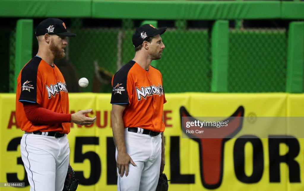 Stephen Strasburg #37 of the Washington Nationals and the National League talks to Max Scherzer #31 of the Washington Nationals and the National League during Gatorade All-Star Workout Day ahead of the 88th MLB All-Star Game at Marlins Park on July 10, 2017 in Miami, Florida.