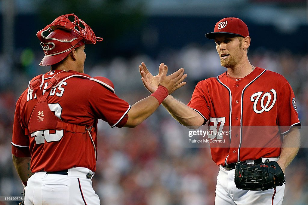 Stephen Strasburg #37 of the Washington Nationals celebrates with Wilson Ramos #40 after throwing his first complete game as the Nationals defeated the Philadelphia Phillies 6-0 during a game at Nationals Park on August 11, 2013 in Washington, DC.