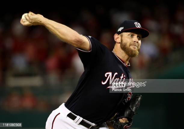 Stephen Strasburg of the Washington Nationals delivers in the first inning of game three of the National League Championship Series against the St...