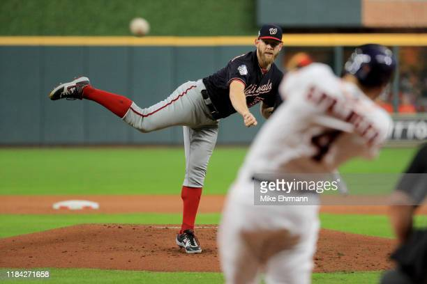 Stephen Strasburg of the Washington Nationals delivers the pitch to George Springer of the Houston Astros who hits a leadoff double during the first...