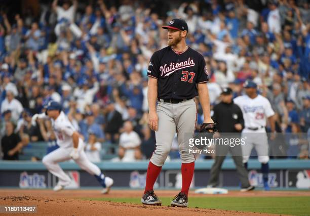 Stephen Strasburg of the Washington Nationals reacts after giving up a two run home run to Max Muncy of the Los Angeles Dodgers of game five of the...