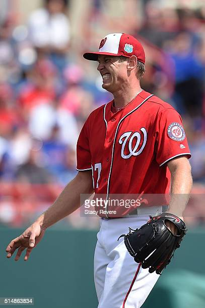 Stephen Strasburg of the Washington Nationals reacts to a pitch during the third inning of a spring training game against the New York Mets at Space...