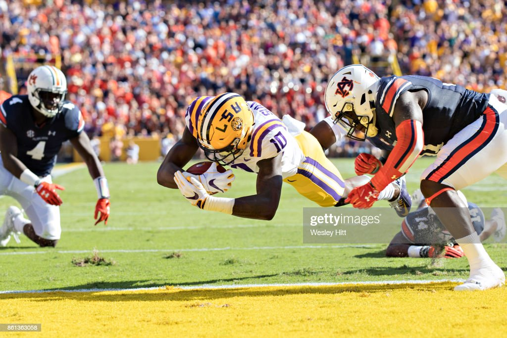 Stephen Sullivan #10 of the LSU Tigers dives into the end zone for a touchdown during a game against the Auburn Tigers at Tiger Stadium on October 14, 2017 in Baton Rouge, Louisiana.