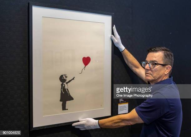 Stephen Swift, project manager makes last minute adjustments at the Art of Banksy Exhibition at Aotea Centre on January 4, 2018 in Auckland, New...