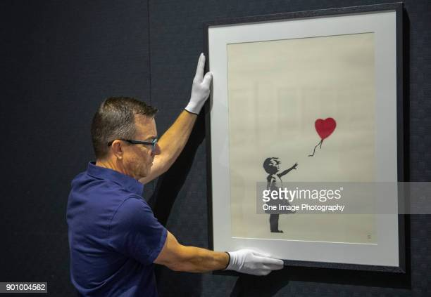 Stephen Swift, project manager, makes last minute adjustments at the Art of Banksy Exhibition at Aotea Centre on January 4, 2018 in Auckland, New...