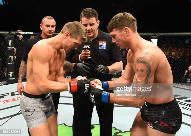 Stephen Thompson and Darren Till of England touch gloves in their welterweight bout during the UFC Fight Night event at ECHO Arena on May 27 2018 in...