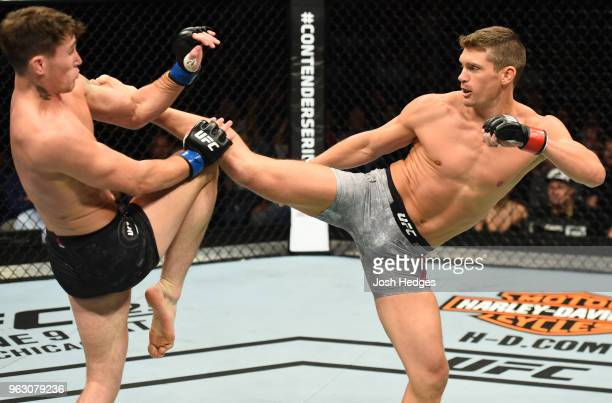 Stephen Thompson kicks Darren Till of England in their welterweight bout during the UFC Fight Night event at ECHO Arena on May 27 2018 in Liverpool...