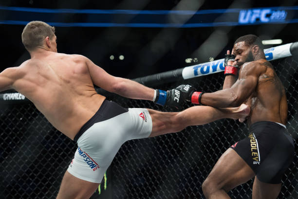 Stephen Thompson kicks Tyron Woodley in their welterweight championship bout during the UFC 209 event at T-Mobile arena on March 4, 2017 in Las...