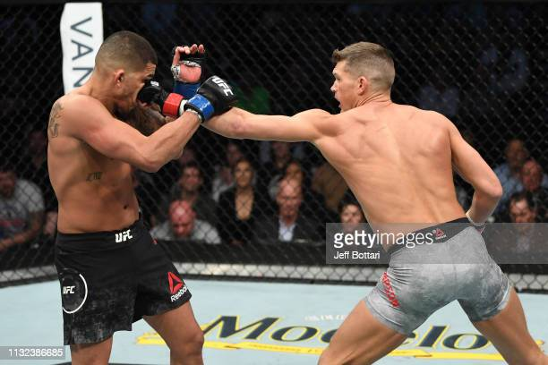 Stephen Thompson punches Anthony Pettis in their welterweight bout during the UFC Fight Night event at Bridgestone Arena on March 23 2019 in...