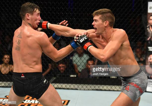 Stephen Thompson punches Darren Till of England in their welterweight bout during the UFC Fight Night event at ECHO Arena on May 27 2018 in Liverpool...
