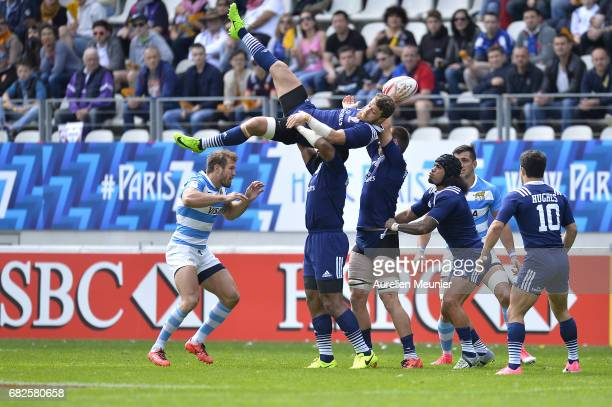 Stephen Tomasin of the United States of America jumps for the ball during the HSBC rugby sevens match between the United States of America and...