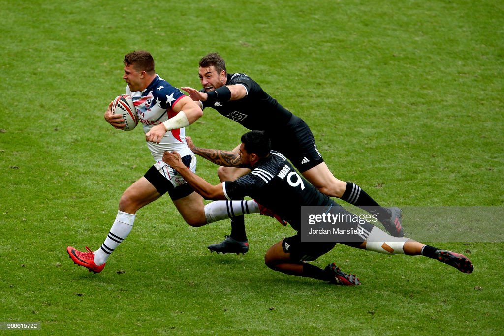 Stephen Tomasin of the USA is tackled by Regan Ware and Kurt Baker of New Zealand on day two of the HSBC London Sevens at Twickenham Stadium on June 3, 2018 in London, United Kingdom.