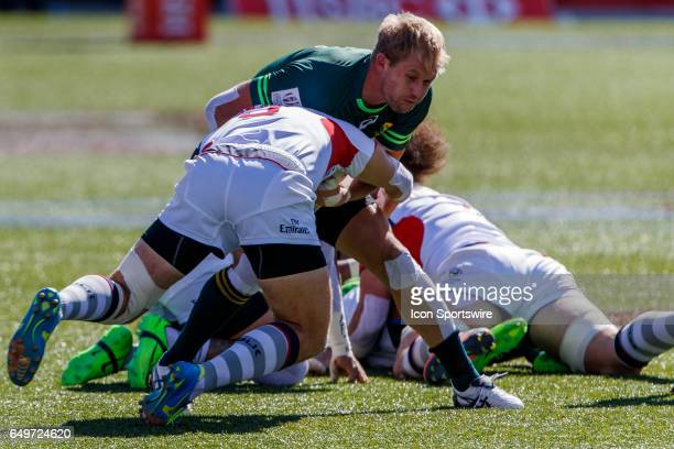Stephen Tomasin of USA makes a heavy tackle on Dylan Sage of South Africa during the Cup Semi Final match between South Africa and the United States...