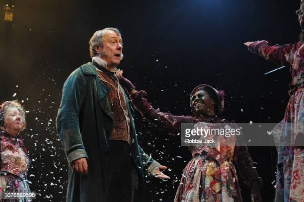 Stephen Tompkinson as Ebenezer Scrooge with artists of the company in Jack Thorne's adaptation of Charles Dickens' A Christmas Carol directed by...