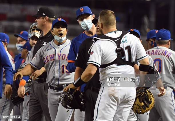 Stephen Vogt of the Arizona Diamondbacks argues with manager Luis Rojas of the New York Mets during the sixth inning at Chase Field on June 01, 2021...