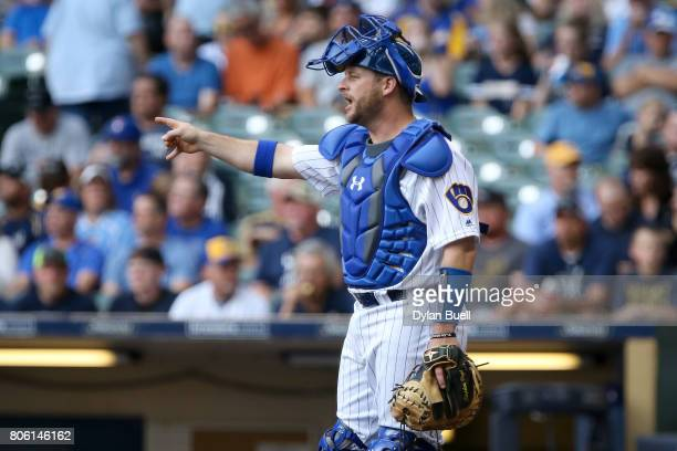Stephen Vogt of the Milwaukee Brewers calls out instructions in the first inning against the Miami Marlins at Miller Park on June 30 2017 in...