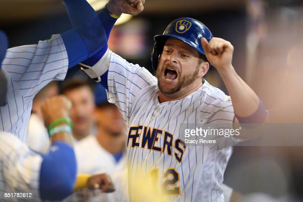 Stephen Vogt of the Milwaukee Brewers celebrates a solo home run during the second inning of a game against the Chicago Cubs at Miller Park on...