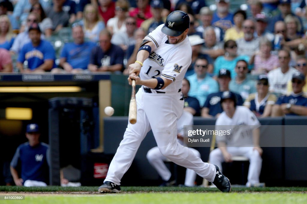 Stephen Vogt #12 of the Milwaukee Brewers hits a single in the second inning against the St. Louis Cardinals at Miller Park on August 30, 2017 in Milwaukee, Wisconsin.