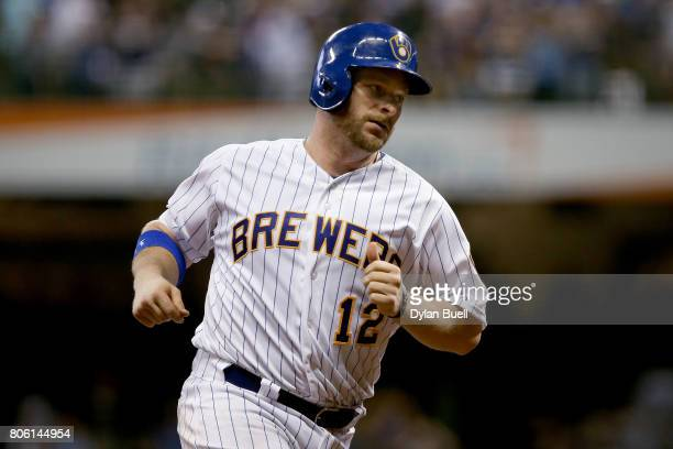 Stephen Vogt of the Milwaukee Brewers rounds the bases after hitting a home run in the fifth inning against the Miami Marlins at Miller Park on June...