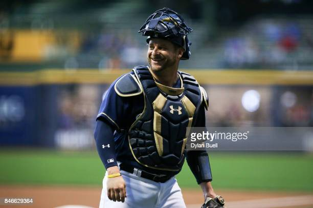 Stephen Vogt of the Milwaukee Brewers walks off the field in the second inning against the Pittsburgh Pirates at Miller Park on September 12 2017 in...