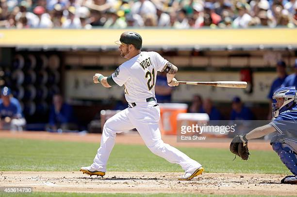 Stephen Vogt of the Oakland Athletics bats against the Toronto Blue Jays at Oco Coliseum on July 6 2014 in Oakland California