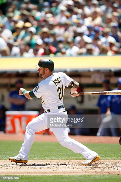 Stephen Vogt of the Oakland Athletics bats during the game against the Toronto Blue Jays at Oco Coliseum on July 6 2014 in Oakland California The...
