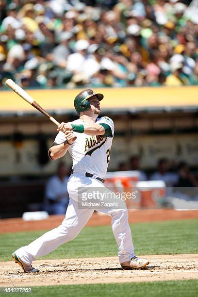 Stephen Vogt of the Oakland Athletics bats during the game against the Minnesota Twins at Oco Coliseum on August 10 2014 in Oakland California The...