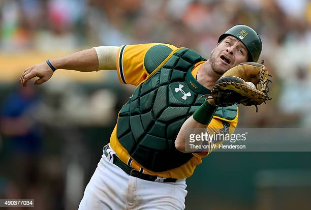Stephen Vogt of the Oakland Athletics catches a foul popup off the bat of Trevor Brown of the San Francisco Giants in the top of the eighth inning at...