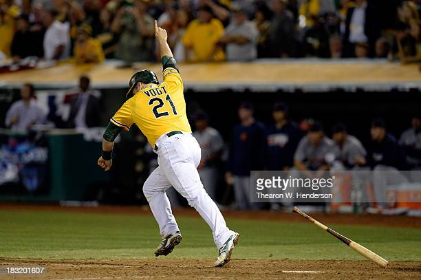 Stephen Vogt of the Oakland Athletics celebrates after scoring the game winning single against Al Alburquerque of the Detroit Tigers in the ninth...