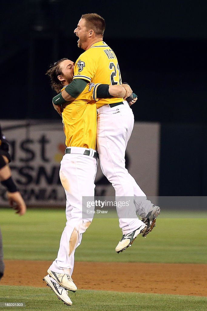 Stephen Vogt #21 of the Oakland Athletics celebrates with his teammates after defeating the Detroit Tigers in Game Two of the American League Division Series at O.co Coliseum on October 5, 2013 in Oakland, California.