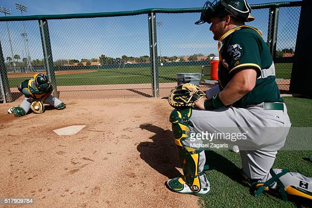 Stephen Vogt of the Oakland Athletics goes through catcher drills during a spring training workout at Fitch Park on March 1 2016 in Mesa Arizona