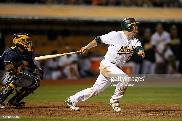 Stephen Vogt of the Oakland Athletics hits a triple against the Milwaukee Brewers during the seventh inning at the Oakland Coliseum on June 21 2016...