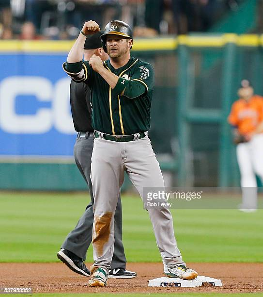 Stephen Vogt of the Oakland Athletics motions to the dugout after hitting a double in the first inning against the Houston Astros at Minute Maid Park...
