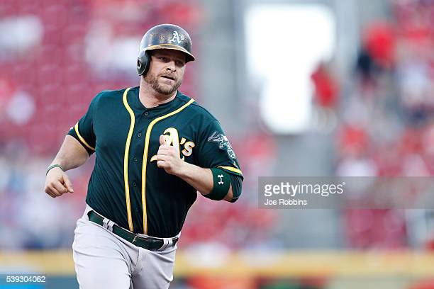 Stephen Vogt of the Oakland Athletics rounds the bases after his solo home run against the Cincinnati Reds in the third inning of the game at Great...