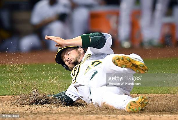 Stephen Vogt of the Oakland Athletics scores on an rbi single from Khris Davis against the Kansas City Royals in the bottom of the forth inning at...