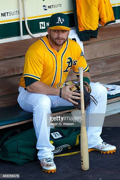 Stephen Vogt of the Oakland Athletics sits in the dugout before the game against the Kansas City Royals at Oco Coliseum on August 1 2014 in Oakland...