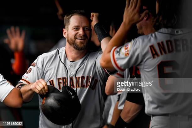 Stephen Vogt of the San Francisco Giants celebrates a fifth inning 2run homer against the Colorado Rockies at Coors Field on July 17 2019 in Denver...