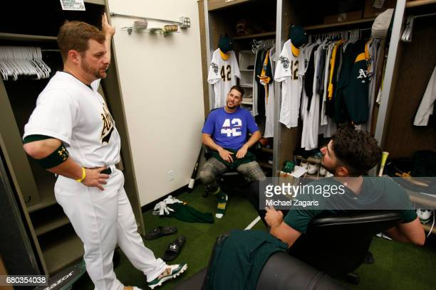 Stephen Vogt Trevor Plouffe and Matt Joyce of the Oakland Athletics talk in the clubhouse prior to the game against the Houston Astros at the Oakland...