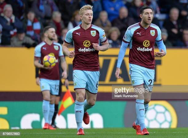 Stephen Ward and Ben Mee of Burnley together during the Premier League match between Burnley and Swansea City at Turf Moor on November 18 2017 in...
